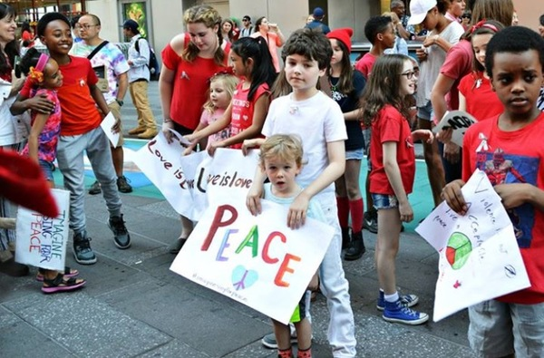Young people from the Broadway community sing John Lennon's 'Imagine' for peace